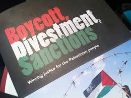 Photo of words Boycott Divesment, Sanction and Palestnian flag