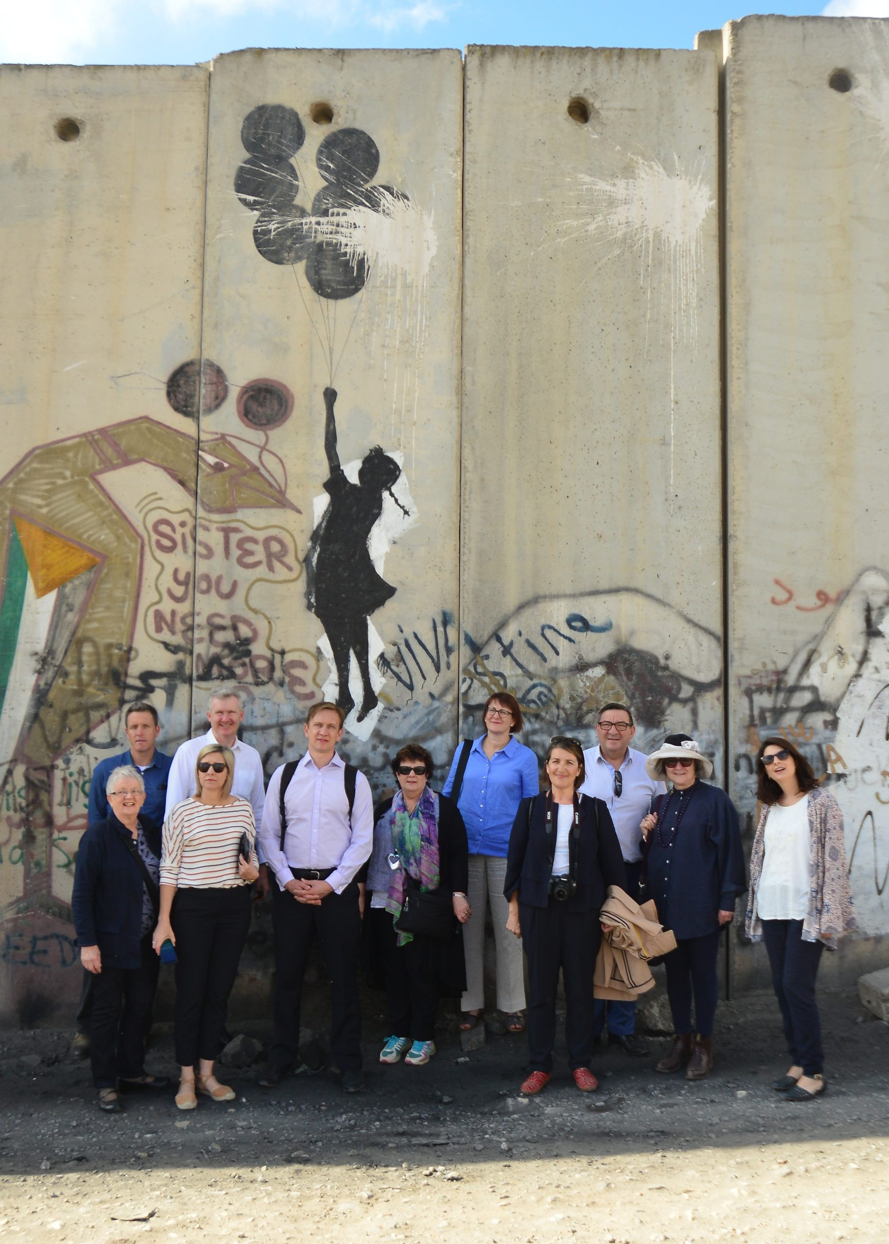 Photo of people beside Israel's Separation wall