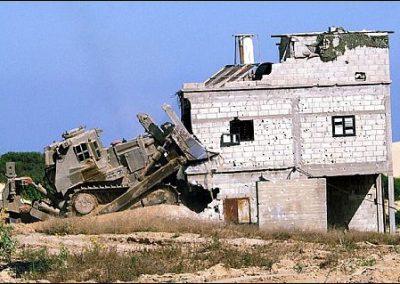 Photo of Israeli bulldozer and pockmarket House